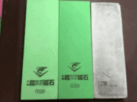 Japanese water stones. From left to right: 400, 1000, 5000 grit