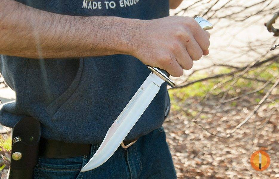 holding a bowie knife