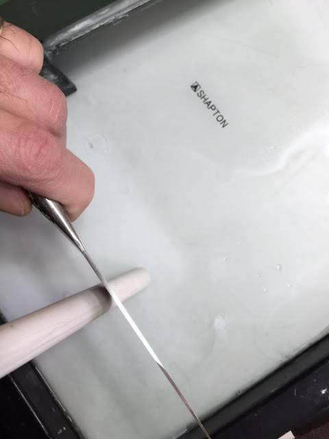Honing a knife on a ceramic hone